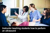Insturctor teaching ultrasound to NMC students