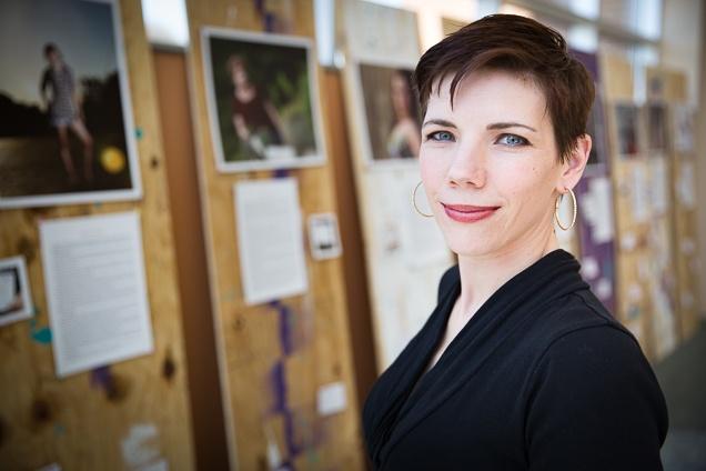 "Teresa Prince Conway with her ""Survivor Stories"" exhibit, debuting at Nebraska Methodist College during Sexual Assault Awareness Month."