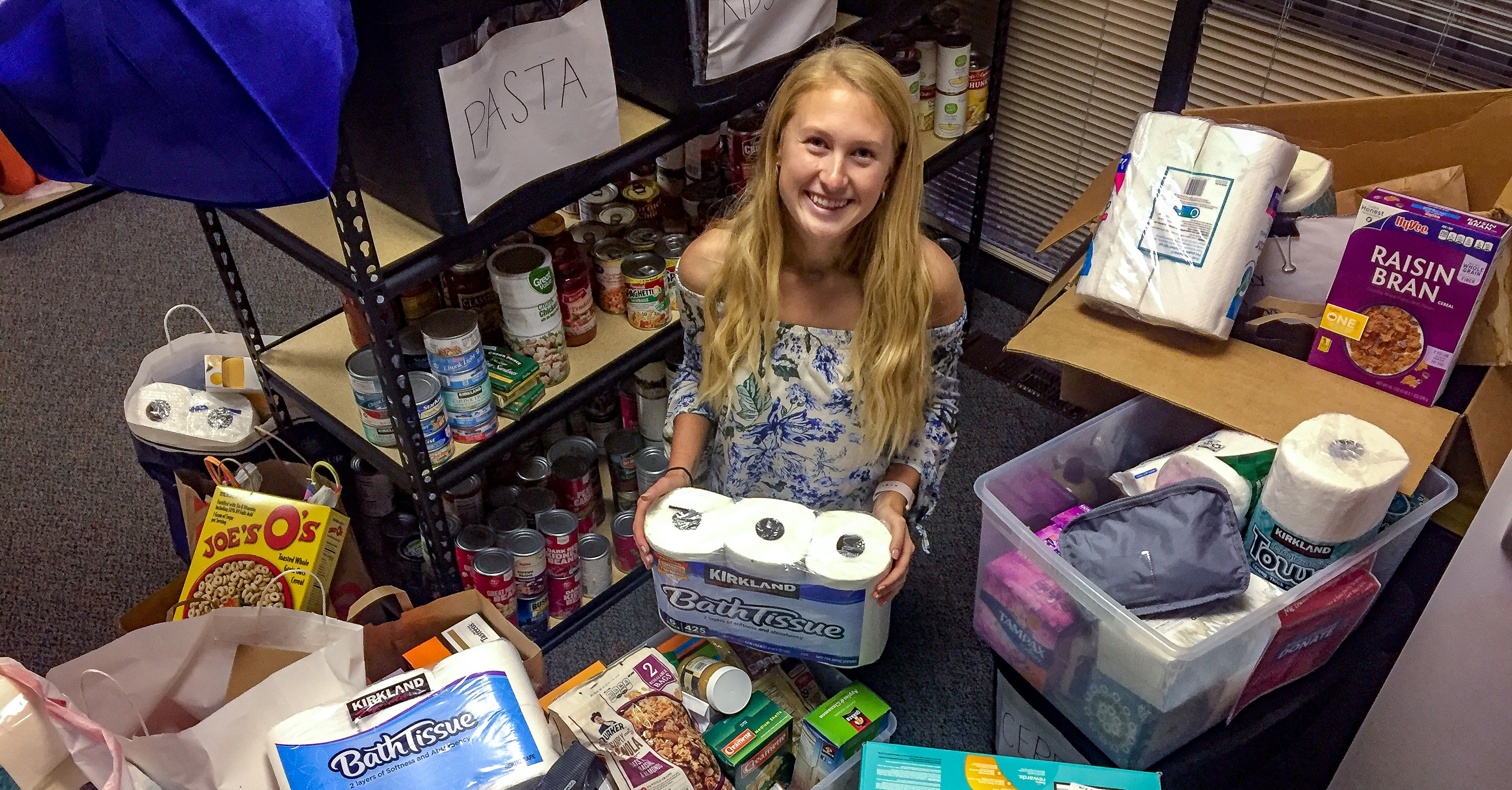 Methodist Volunteen Megan Jacobsen with the 550+ items donated to the NMC Food Pantry.