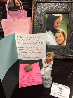 Gift bag, framed photo of Justin & Cheyla, notes, heart-shaped rock.