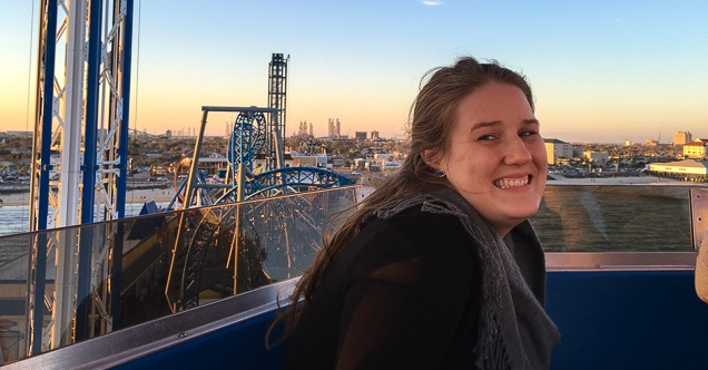 Cheyla Pettett smiling and posing in front of a cityscape