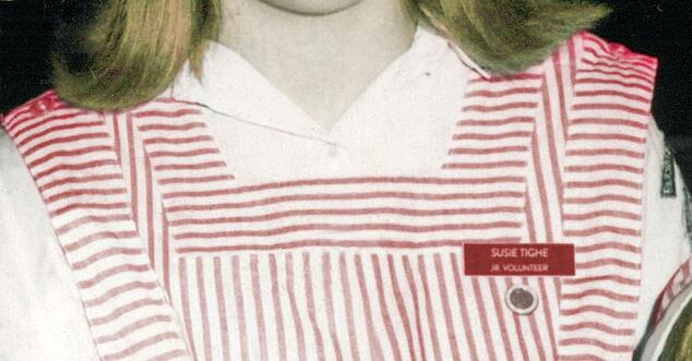Photo illustration of red and white Candy Striper uniform with Susie's nametag and pin.