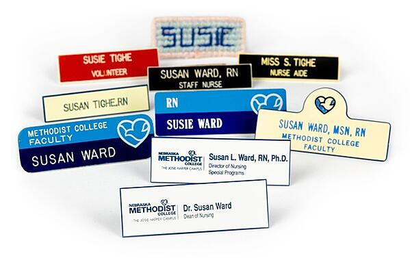 Image of 10 Methodist ID badges worn by Susie Ward over the years, from volunteer Candy Striper to Dean of Nursing.