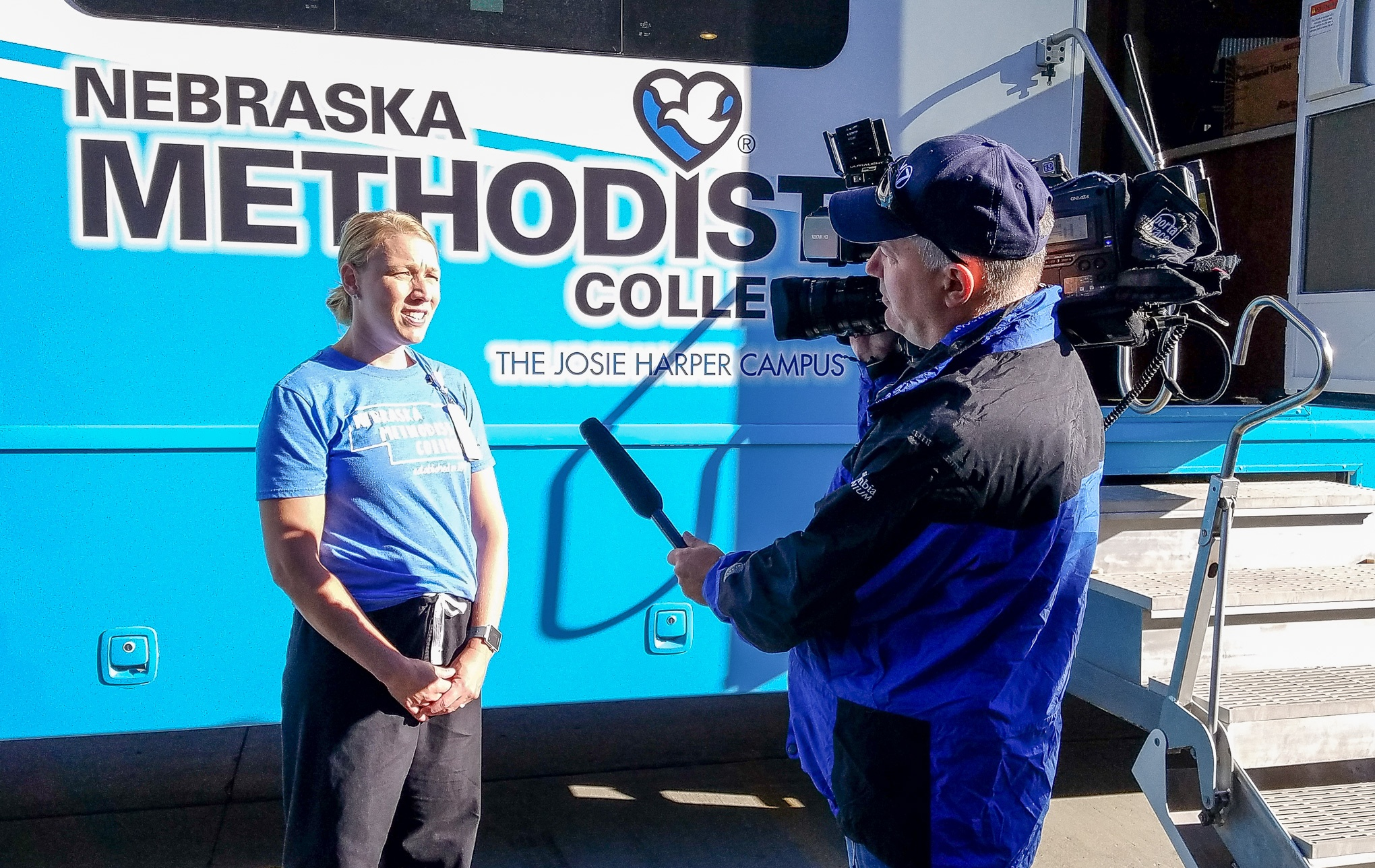 KETV reporter interviews Dr. Sisson on-camera in front of Mobile Diabetes Center.
