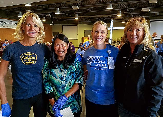 Holly Hollenbeck, Jenny Johnson, Jillian Sisson, Deb Carlson. at the Foot Care Clinic for the Homeless.