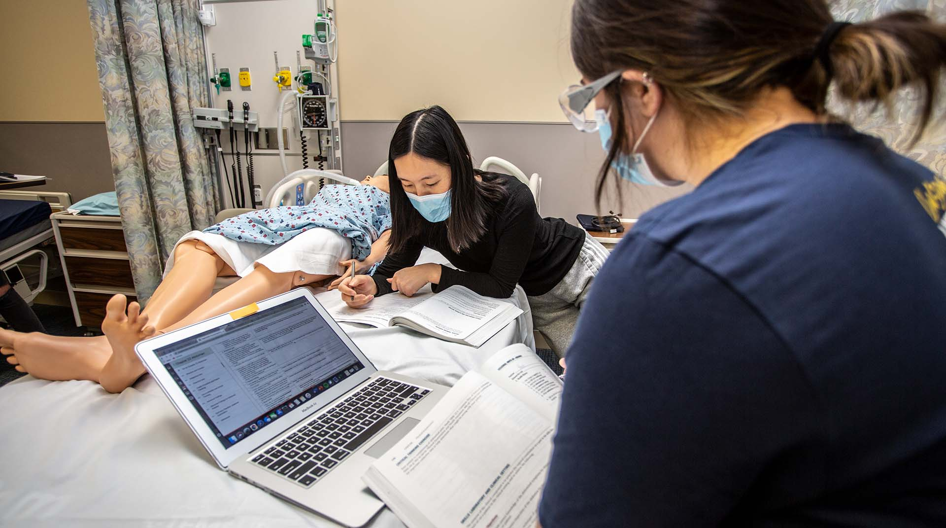 Nursing students studying in a lab at Nebraska Methodist College.
