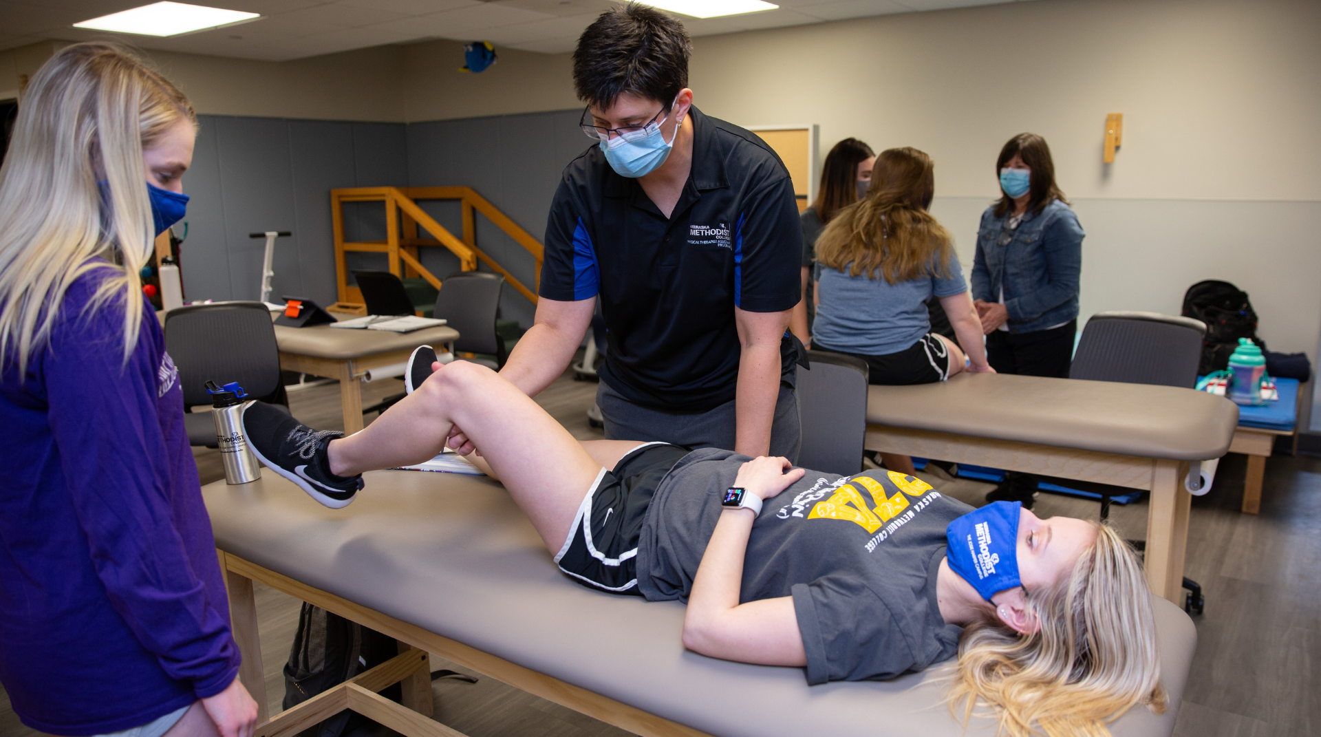 Nebraska Methodist College Physical Therapist Assistant Director Shannon Struby teaches students in a classroom.