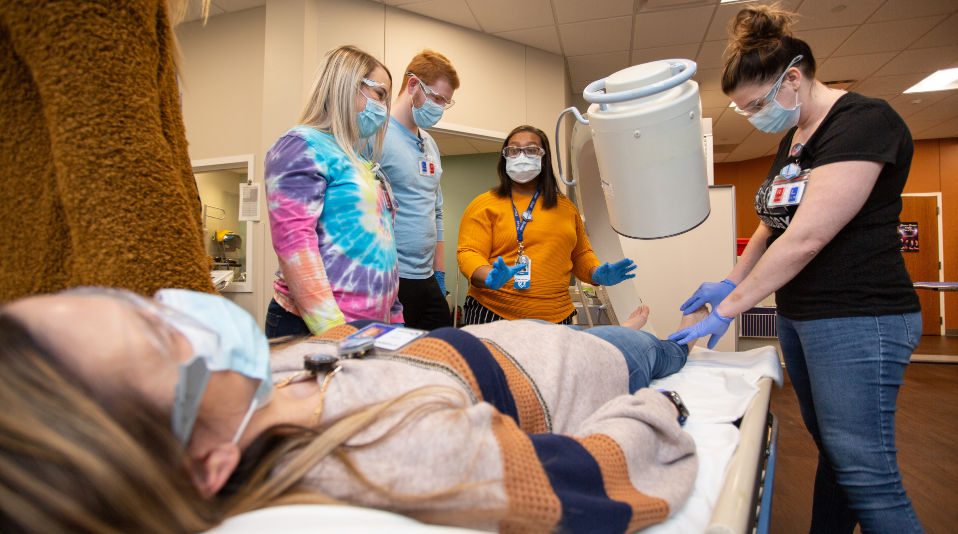 A Nebraska Methodist College faculty members teaches a group of students in the radiologic technology lab on campus.