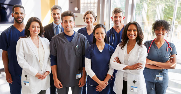 A group of healthcare workers show the variety of jobs in the healthcare sector.