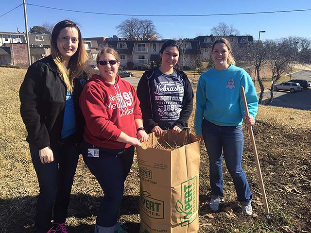 Three of the students who worked on the NMC Community Garden this week to preparing the ground for spring planting.