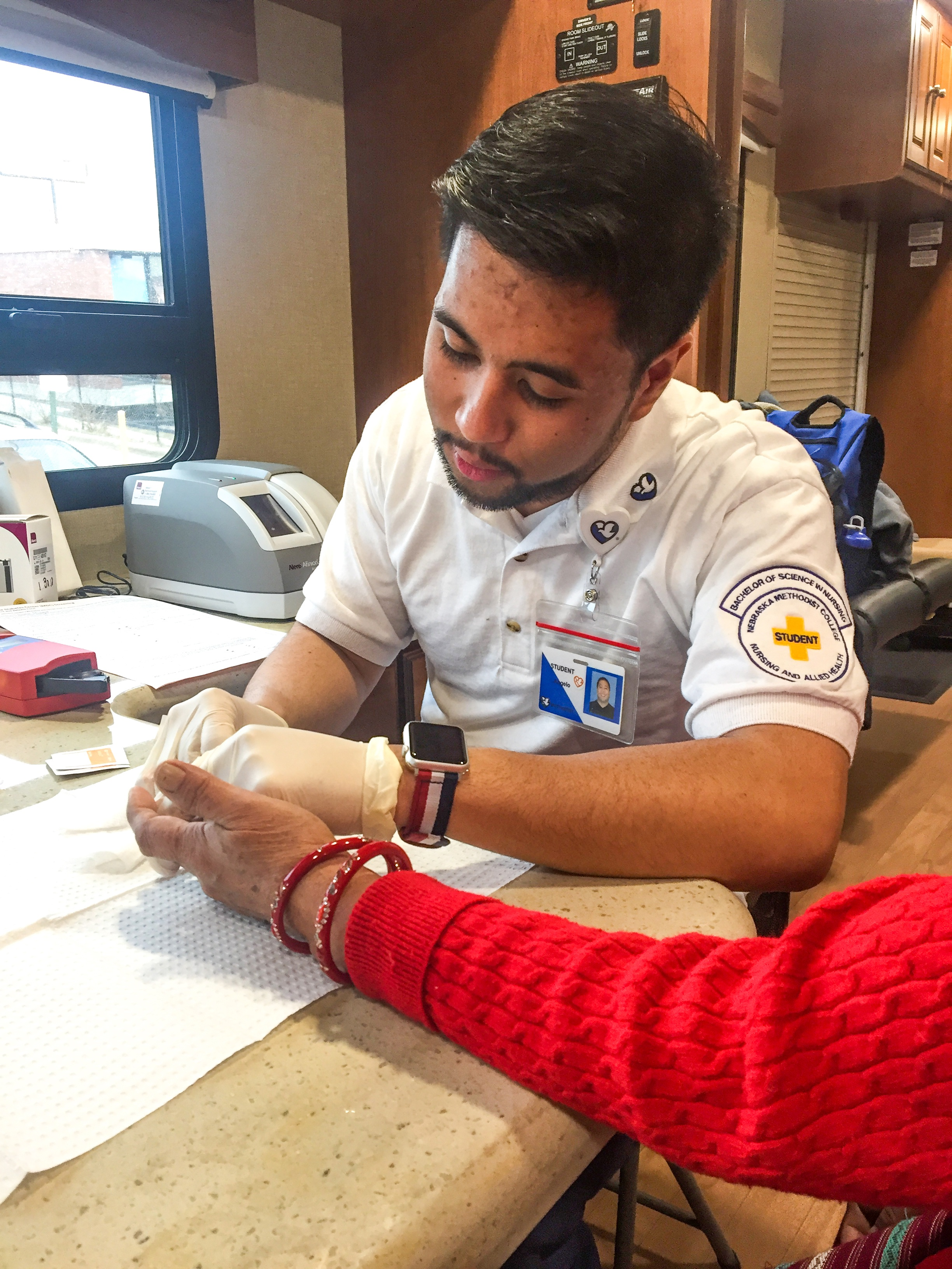 NMC nursing student Angelo Andal provides a diabetes screen.