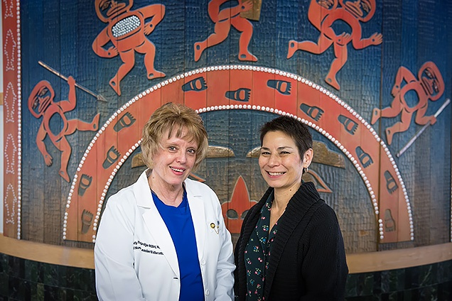 Nebraska Methodist College alums Candy Rutledge, left, and Diane Heine, right, met as coworkers here at Alaska Native Medical Center.