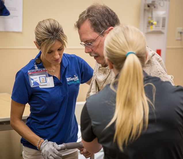 Nebraska Methodist College student in the Master of Occupational Therapy program helping a patient with daily living skills.