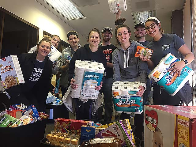 Nursing students moving food and toiletries to a new, larger location for the Nebraska Methodist College's Food Pantry, stocked with non-perishable grocery items for students in need.