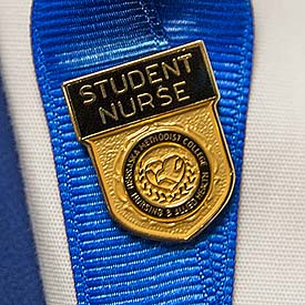 The Nebraska Methodist College student nurse pin.