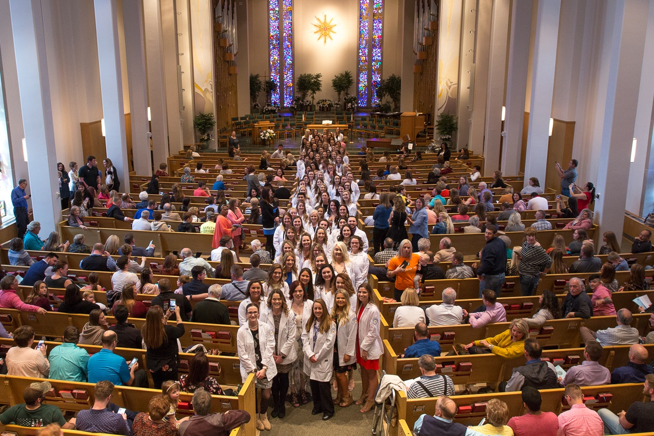 Ninety NMC nursing students line the aisle of First United Methodist Church just prior to the Edna A. Fagan Pledging Ceremony on April 13.