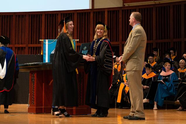 NMC President & CEO Deb Carlson congratulates a new graduate.