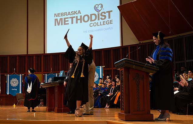 A joyful moment onstage after a student  receives her diploma.