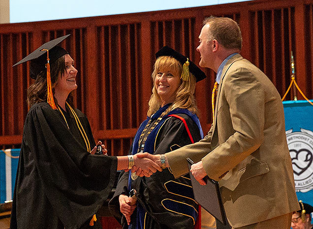 Christa Reisdorff receives her diploma at NMC's Spring 2018 Commencement.