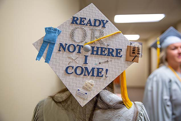 """A graduate's cap reads: """"Ready O.R. Not, Here I Come!"""""""