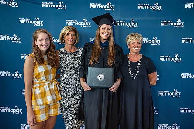 New MOT grad Megan Vermeer with her sister, mother and Aunt Gina.