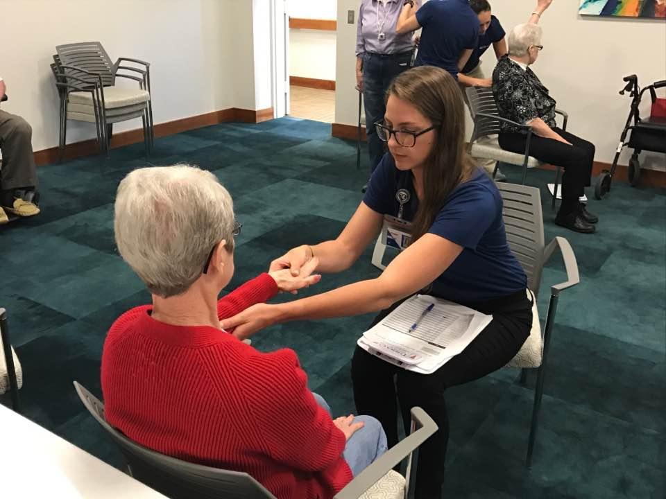 NMC MOT student Megan Vermeer practicing patient assessments.