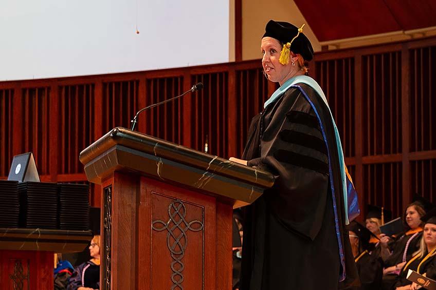Melissa Kimmerling, EdD, MOT, OTR/L, director and creator of the Nebraska Methodist College MOT program, giving a commencement speech.