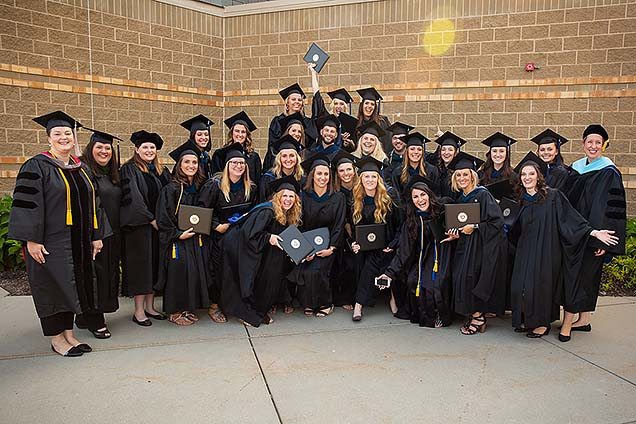 First class to graduate from Nebraska Methodist College Master of Occupational Therapy (MOT) program, in caps and gowns after August 3 commencement ceremony.