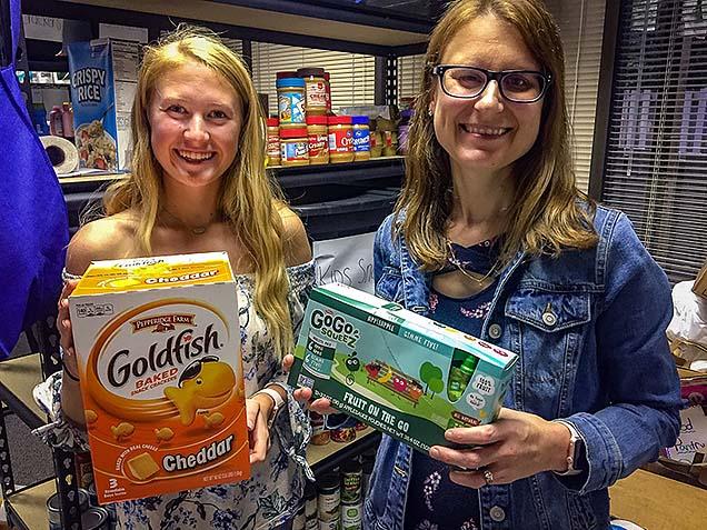 Methodist Volunteen Megan Jacobsen and Dr. Lisa Johnson at the NMC Food Pantry.