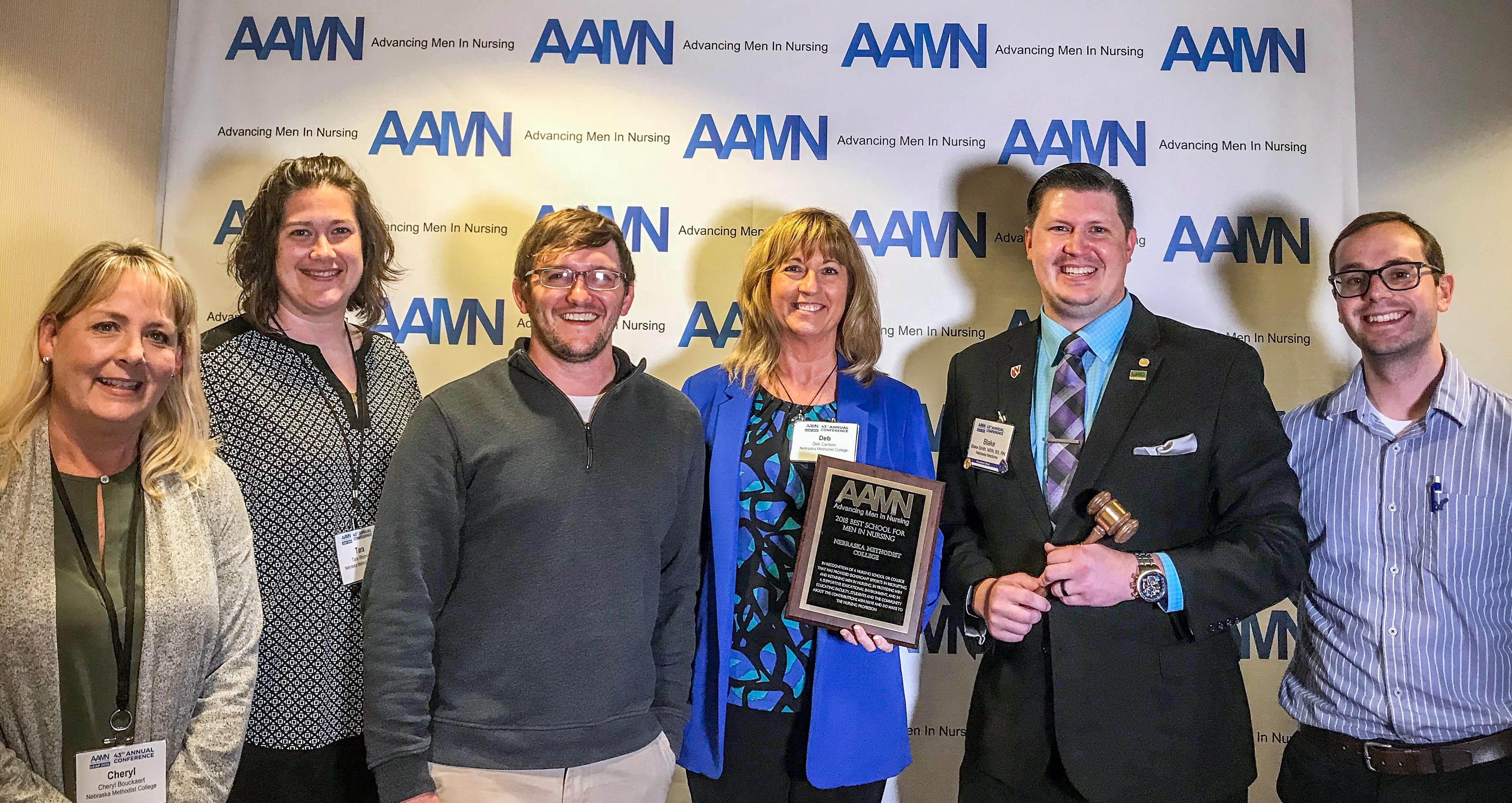 Shown at the AAMN Conference with the 2018 Best Schools Award, from left: NMC Assistant Professor Cheryl Bouckaert, MSN, BSN, RN; NMC BSN-DNP Program Director Tara Whitmire, DNP, APRN-NP; NMC DNP student and alumnus Troy Beekman BSN, RN; NMC President/CEO Deb Carlson, PhD; AAMN President and NMC alumnus Blake Smith, MSN, BSN, RN; NMC ACE Program nursing student Nathan Johnson.