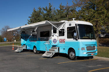 "Nebraska Methodist College's mobile diabetes center. A blue and white bus with the words ""Mobile Diabetes Center"" printed on the side"