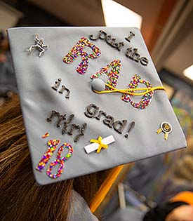 Image of a personally decorated cap of an NMC rad tech grad