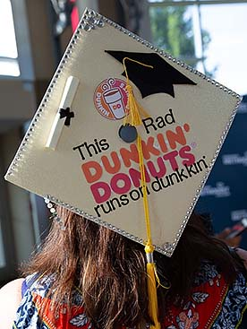 Image of a decorated cap at NMC summer commencement 2018