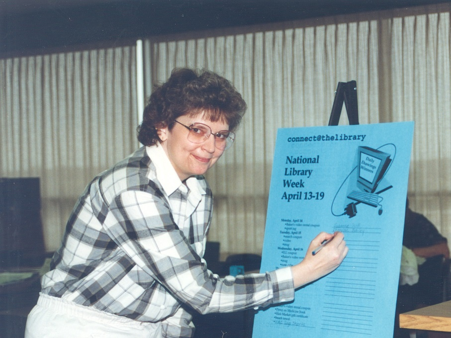 In this historic photo, Nebraska Methodist College Directory of Library Services Bev Sedlacek gets ready for National Library Week.