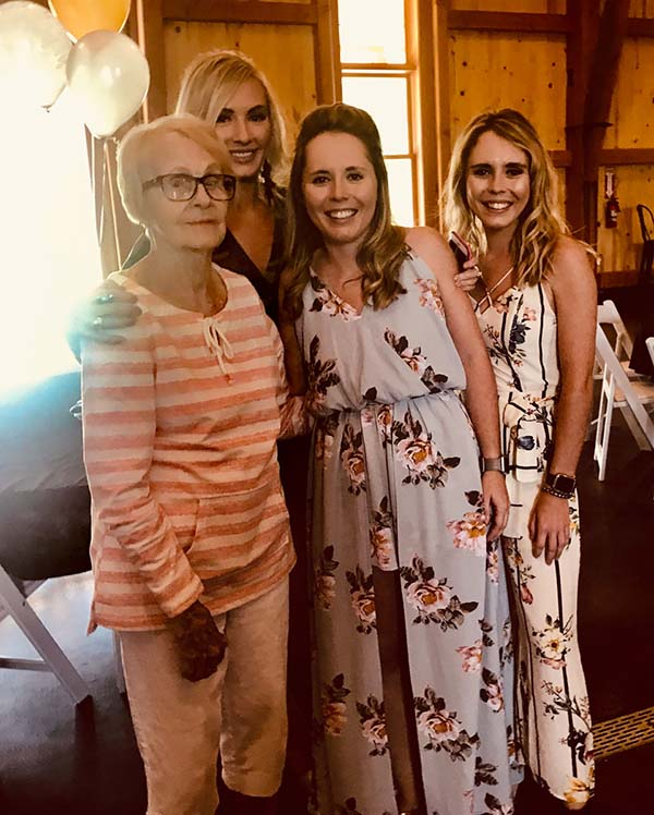 The three Rodgers sisters -- Betsy, Jane and Annie -- post with their grandmother, Kathryn Pfeiffer, at her 90th birthday celebration.