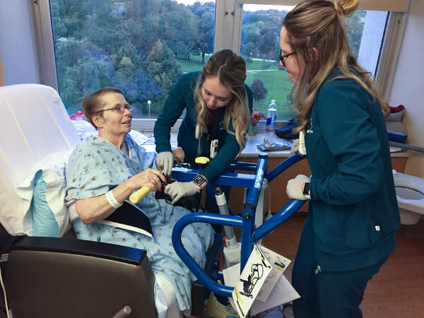 Leona Anderson receives care from Annie and Jane Rodgers.