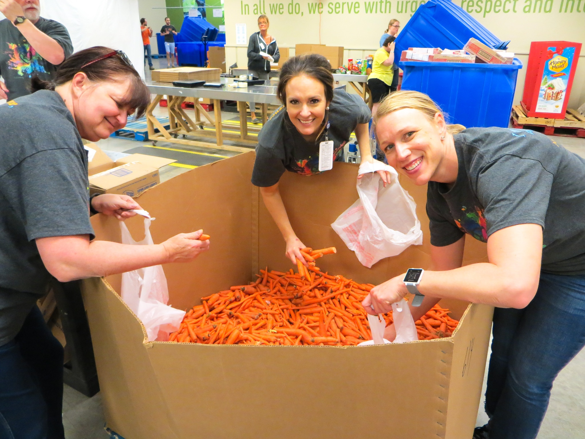 NMC faculty and staff volunteer at the Food Bank for the Heartland.