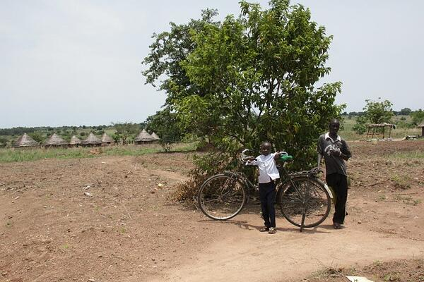 Anna was 13 years old when she left Sudan. In the background of this photo is her village.