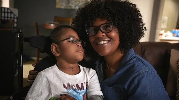 Latoya and son smiling