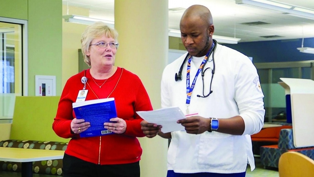 """Maurice """"Mo"""" Gregory III, pictured here with Dr. Susie Ward, took several detours on the way to finding his place in the healthcare community."""