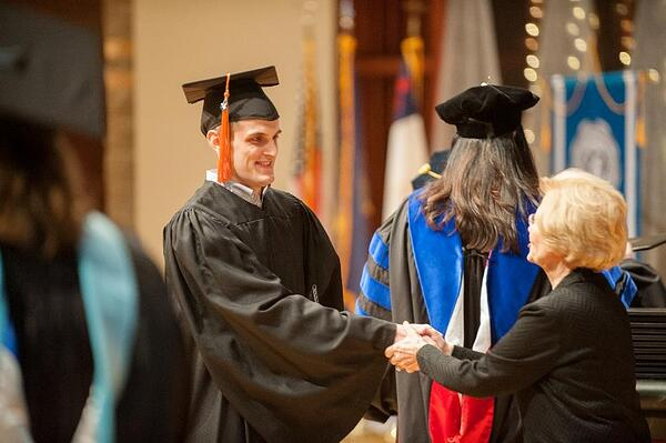 Board member Ruth Freed congratulates new BSN graduate Kevin Kirshenbaum.