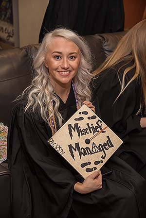 "New BSN shows her decorated graduation cap. The cap is Harry Potter themed and is made to look like the Marauders Map, reading ""Mischief Managed"""