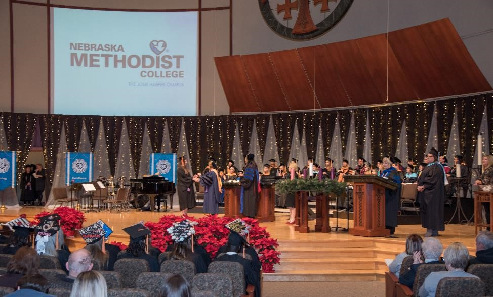 Diploma presentation during Nebraska Methodist College's fall commencement ceremonies at St. Andrew's United Methodist Church.