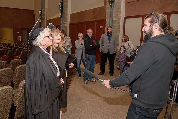 KMTV Channel 3 reporter interviews Lisa and Cassandra Kessler.