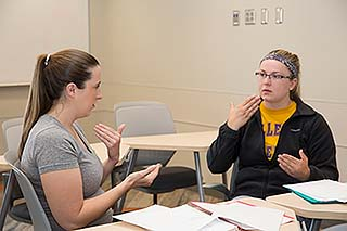 Students practice with each other during Patti Reitz's Healthcare Sign Language class.